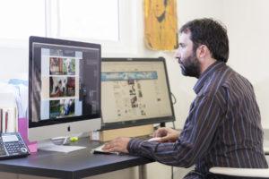 Staff designing website for client.