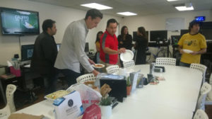 Staff eating shared lunch.