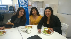Staff eating lunch together.