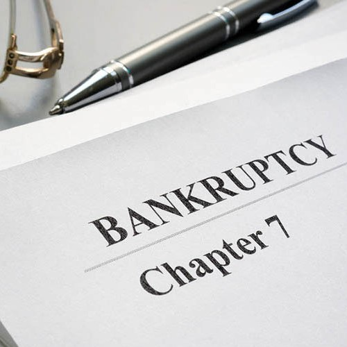 Chapter  Bankruptcy Petition With Pen And Glasses
